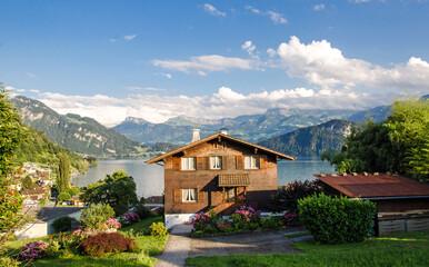Swiss mountain hut on a lake with a wonderful garden :)