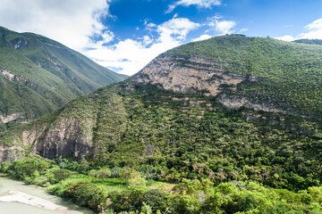 Utcubamba river valley with ruins of Macro, group of pre-Inca dwellings and burial chambers built on the side of a mountain, northern Peru