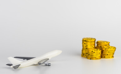 Saving gold money for air plane ticket vacation travel