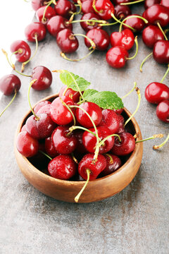 Cherry bowl with sweet cherries with leaf