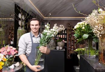 Handsome florist in flower shop