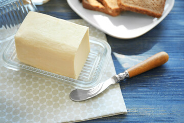Composition with butter on wooden table