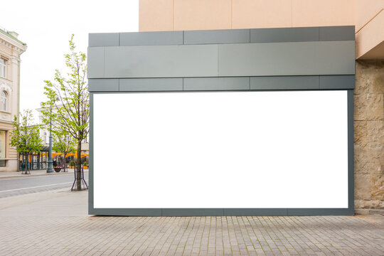 Mock up of big store blank showcase window in a city