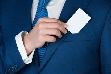 young man takes out blank business card from the pocket