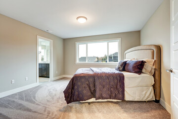 Beige master bedroom with king size bed