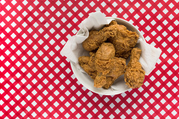Fried chicken on red checkerboard tablecloth