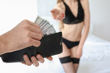 Man paying prostitute for her services