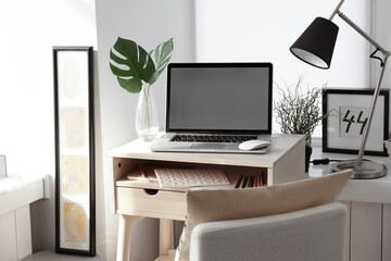Creative workplace near windowsill in modern room