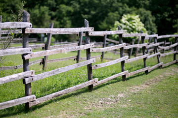 Old wooden rural corral fence in meadow
