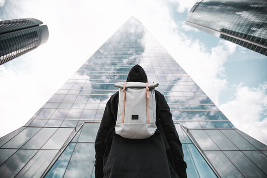 Urban backpacker in the city with background buildings