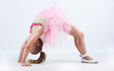 Little ballerina girl back bend bridge