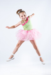 Young ballerina jumping and exercising