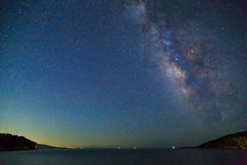 Milky way over the sea in kargi beach near Datca, Turkey
