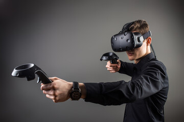 young man playing games with virtual reality goggles