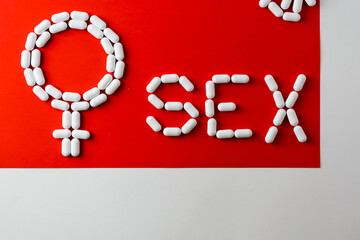 word sex, capsules and tablets. Concept - protection, contraception, conception, relationships between a man and a woman. female symbol