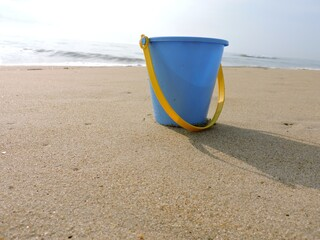 Blue bucket at the beach