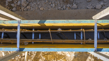Top view of metals rod supports inside wall