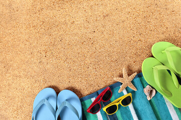 Summer beach background border, flip flops, sand copy space