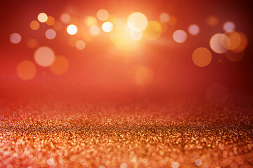 Red glitter and gold lights bokeh abstract background. defocused.