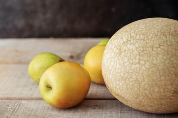 Apples on wooden floor.