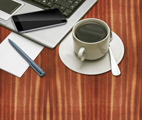 Business communications - laptop, smart mobile phone and cup of coffee on a desktop, with plenty of copy space