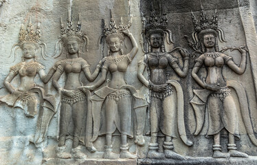 Detail of a Stone Carved Relief in the famous Angkor Wat in Cambodia and the largest religious monument in the world. Location: Siem Reap, Cambodia. Artistic picture. Beauty world.