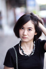 Young asian woman on the street, Close up portrait of beautiful girl.