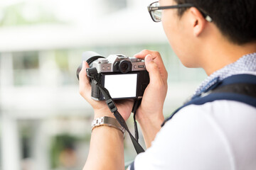 young asian travel with backpack and camera travel in Bangkok ci