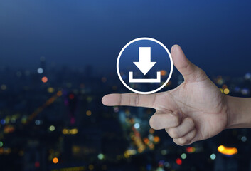 Download icon on finger over blur colorful night light city tower, Business internet concept