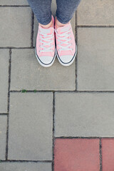 Closeup of woman's legs and sneakers