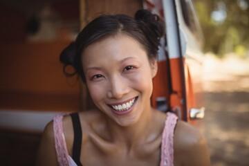 Portrait of smiling woman sitting in mini van