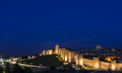 Panoramic view of the historic city of Avila at the blue hour, Castilla y Leon, Spain