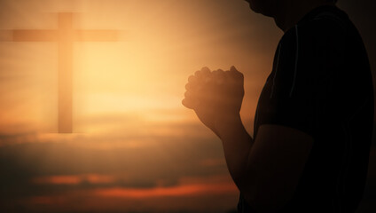 Christian man praying worship at sunset. Hands folded in prayer. worship god with christian concept religion.