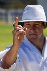 Umpire signalling out during match
