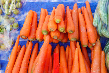 Fresh garden carrots. Bunch of fresh organic carrots at market.