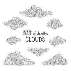 Vector outlined doodles clouds set.