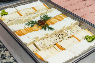 Tray of sliced different kind of cheese