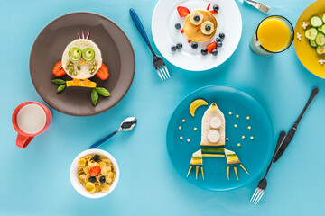 flat lay with creatively styled children's breakfast with drinks on plates