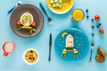 flat lay with creatively styled children's breakfast on colorful tabletop