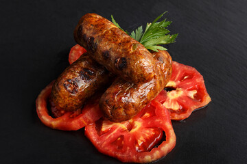 grilled sausages with tomato
