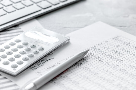 accounting work space with calculator, profit and tables on stone desk close up