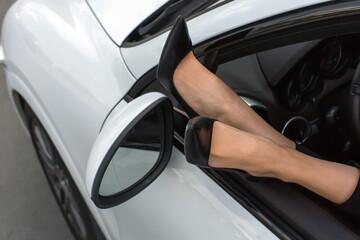 Female legs out car window