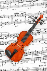 Wall Mural - Toy violin and music sheet