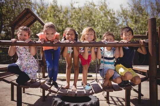 Portrait of happy schoolkids playing in playground