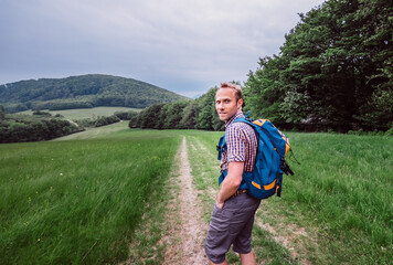 Man walks on mountain hills