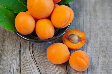 A lot of apricots in a cup, on a rustic table