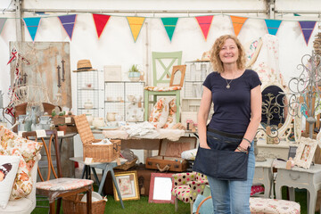 Woman by a vintage crafts stall