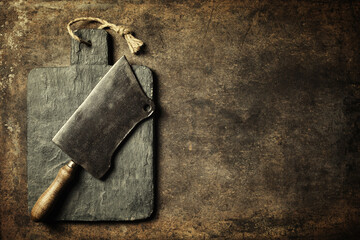 Fototapete - Vintage cutting board and meat cleaver