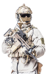 Army soldier in Protective Combat Uniform holding Special Operations Forces Combat Assault Rifle. Mag recovery pouch, chest rig, military boots. Studio shot, isolated on white background