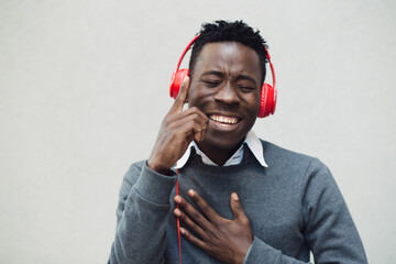 African american man listen music with headphones